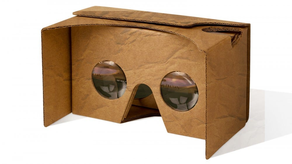 The Google Cardboard VR glasses crumpled and dirty.