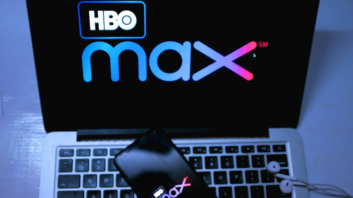 HBO Max service open on smartphone and Apple laptop