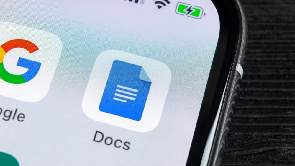 Google Docs app icon on Apple iPhone X screen close up