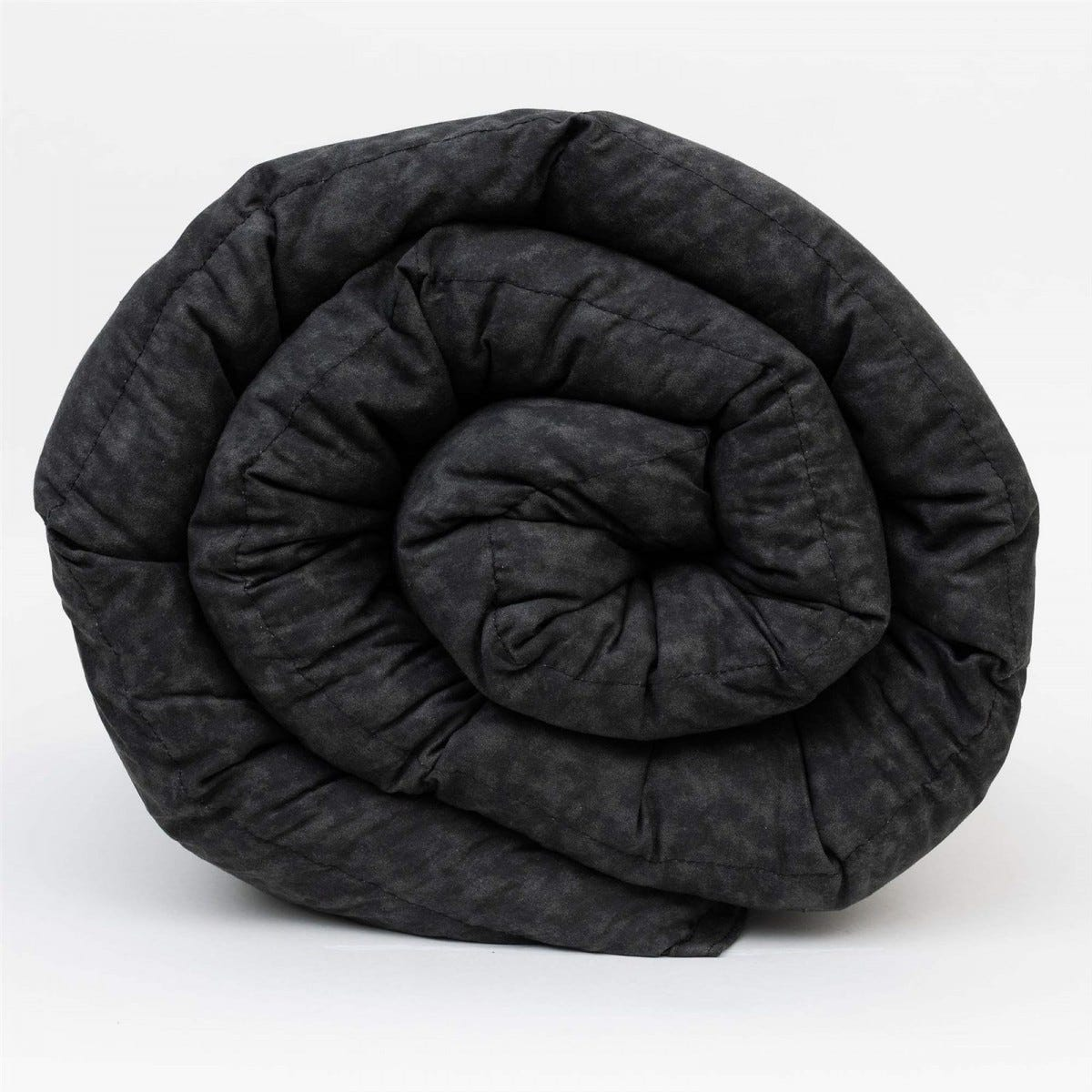 Mosaic black, rolled-up, weighted blanket.