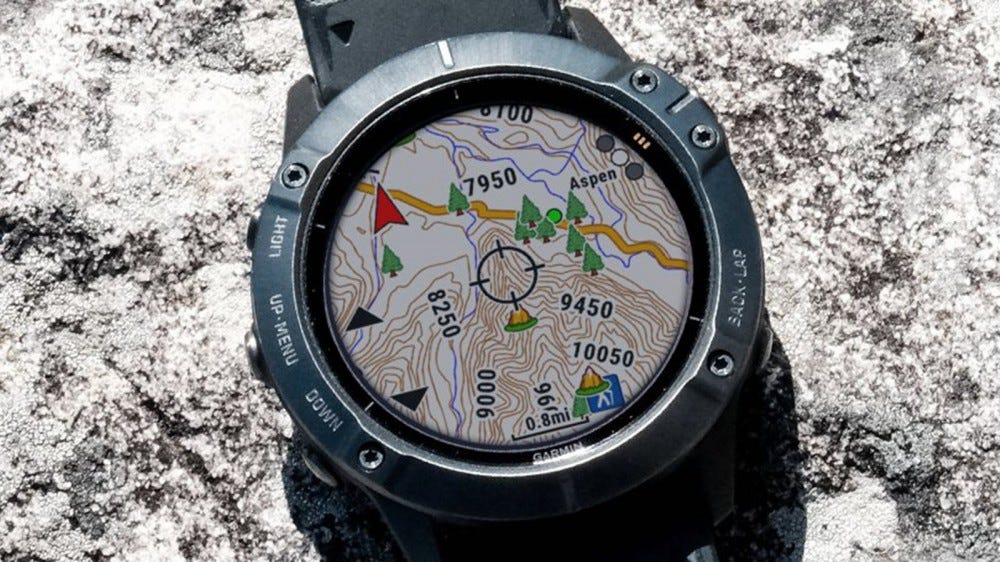 A Garmin smartwatch with a map displayed.