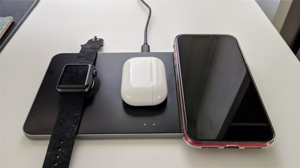The trio mat charges an Apple Watch, AirPods Pro and an iPhone XR at the same time