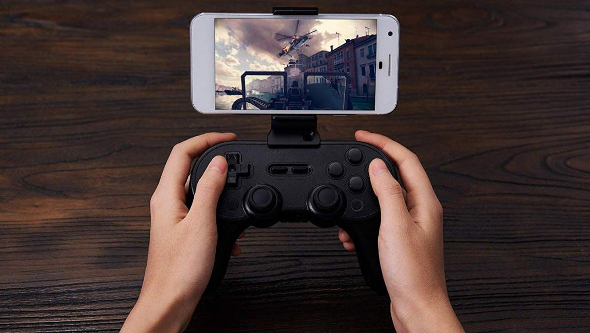 The Sn30 Pro+ with a phone grip installed.