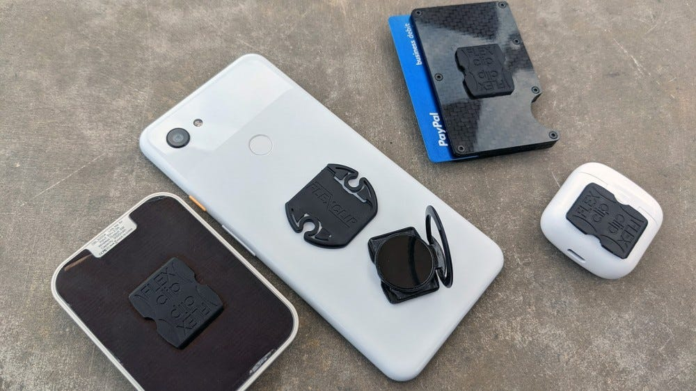 Flexclip attached to phone, battery, phone ring, headphones, and wallet