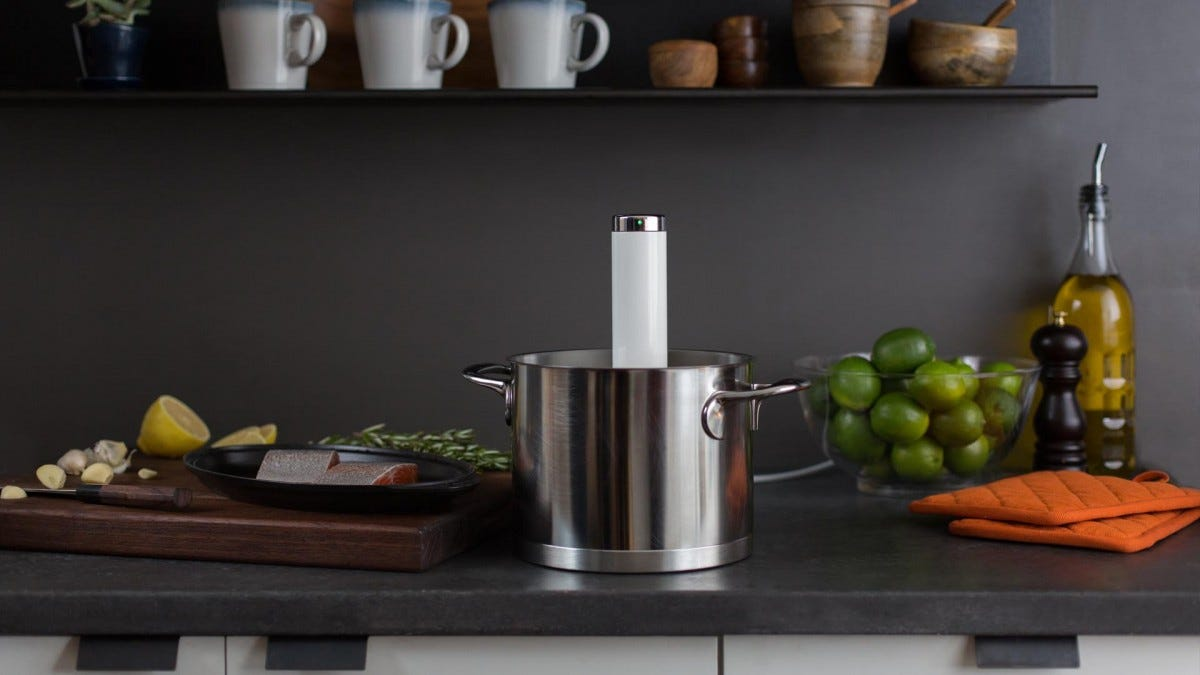 The Chefsteps Joule in a stainless steel pot