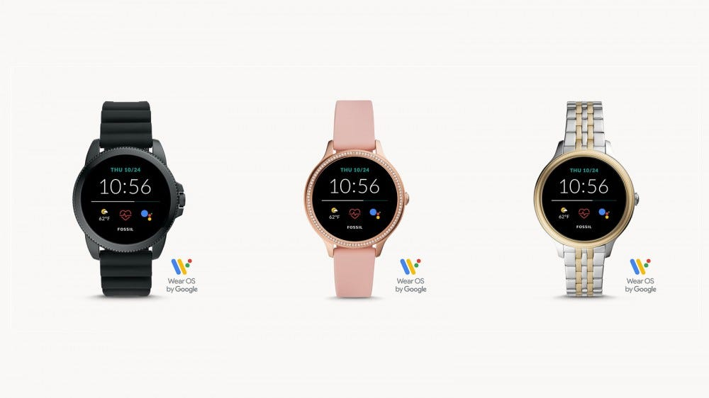 Three Fossil Gen 5E smartwatches in various colors.
