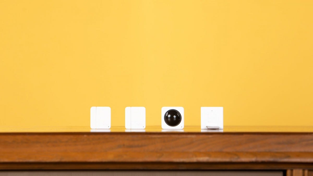 Wyze contact sensors, motion sensors, and bridge in a row.
