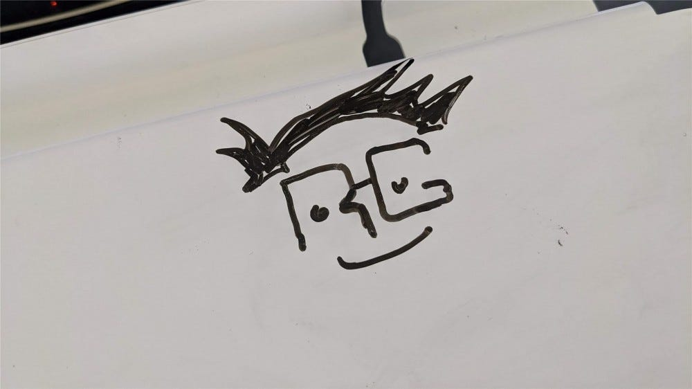A poorly hand drawn version of the RG logo