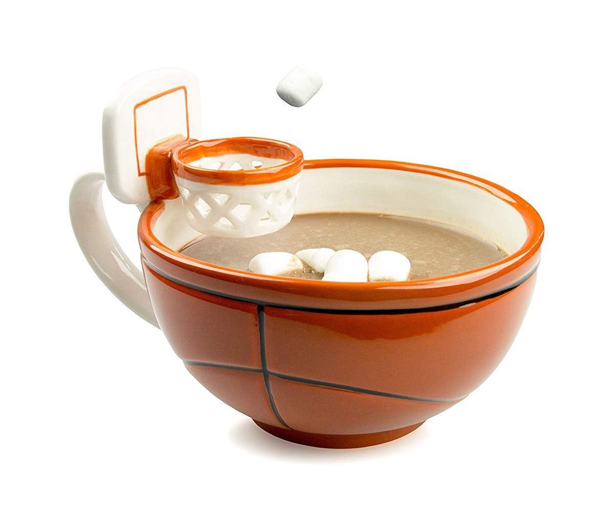 A cocoa mug with a ceramic basketball hoop.