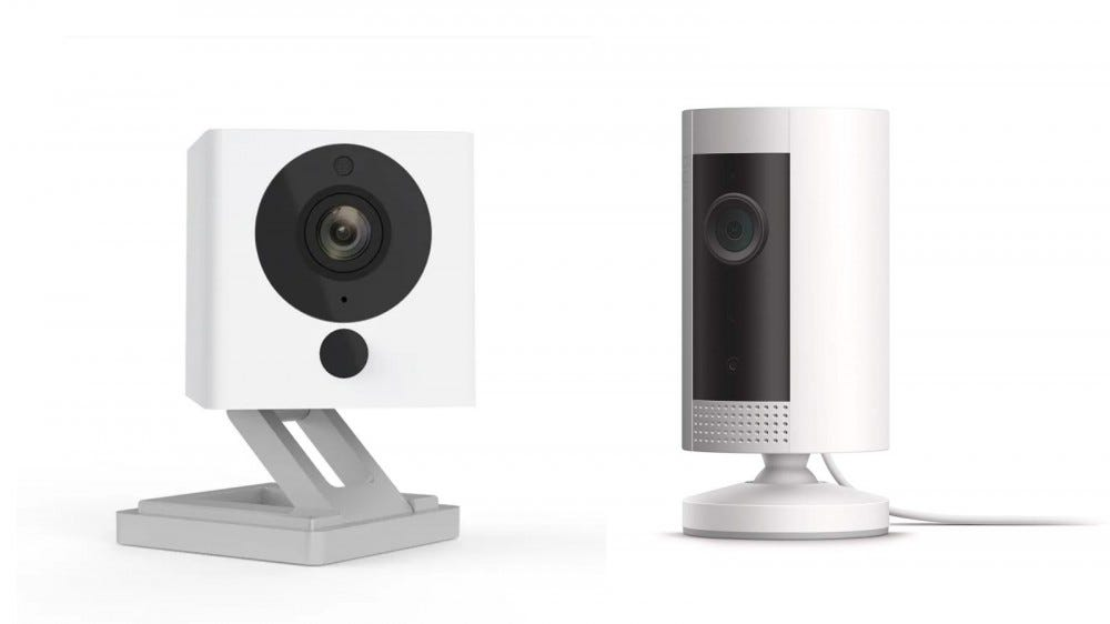 Wyze Cam V2 and Ring Indoor Camera against a white background
