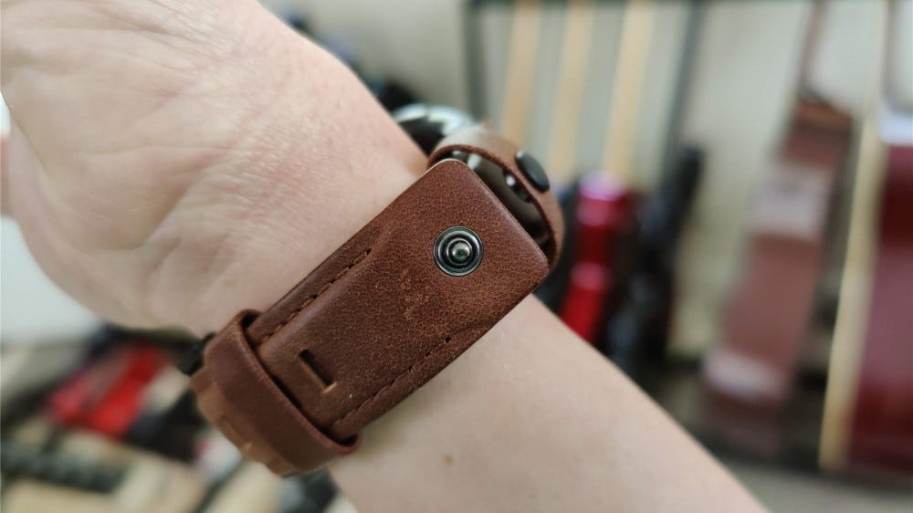 The UAG leather band's button