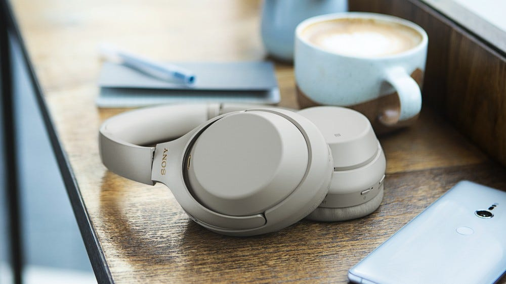 A photo of the Sony WH-1000XM4 headphones on a desk.