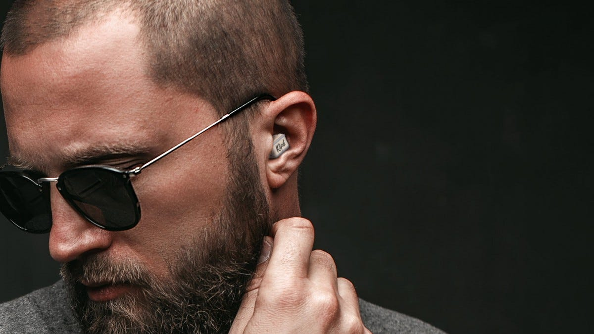 A man wearing the new T10 True Wireless Earbuds tucked nearly into his ear.