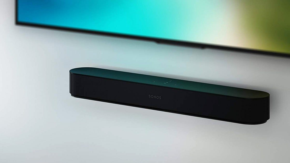 A Sonos Beam mounted to a wall.