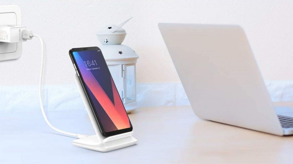 CHOETECH Wireless Charger on a table with phone docked