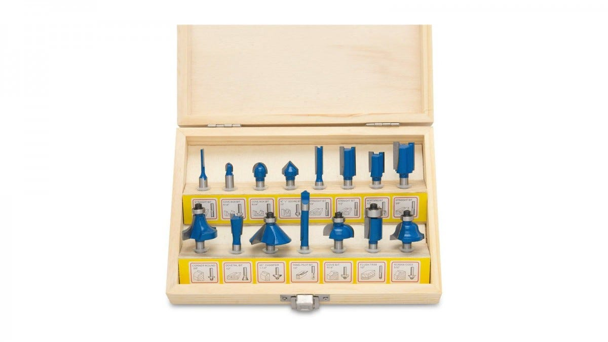 A set of 15 blue router bits in a wooden box.