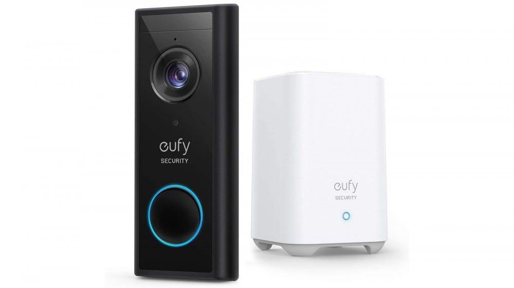 A eufy Video Doorbell next to a white homebase.