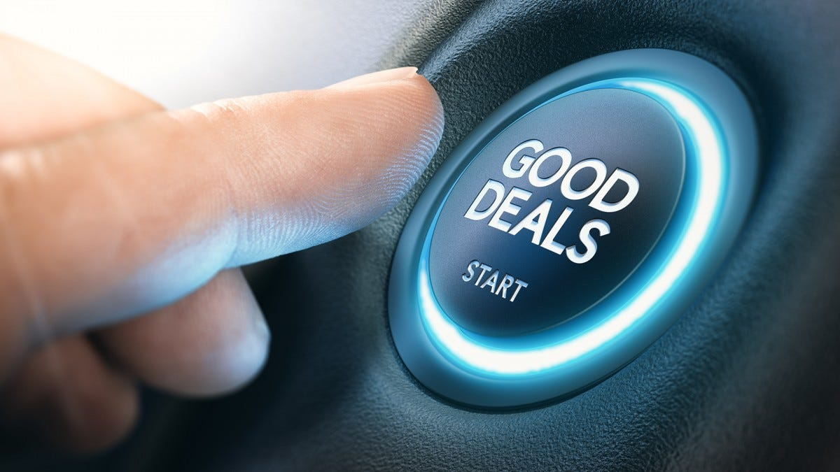 "A finger presses a button labeled ""GOOD DEALS"""