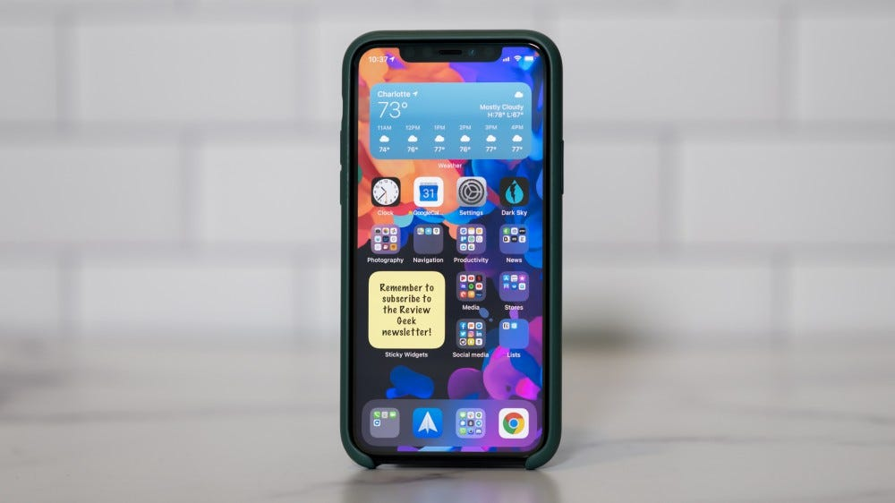 An iPhone with a Sticky Widget reminding you to subscribe to a newsletter.