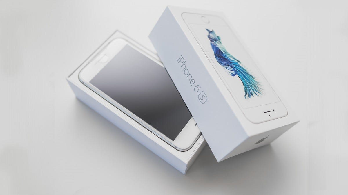 An iPhone 6S in its original box.