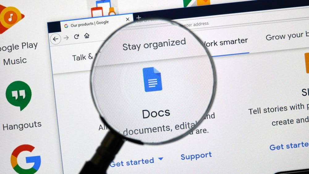A magnifying glass over the Google Docs icon.