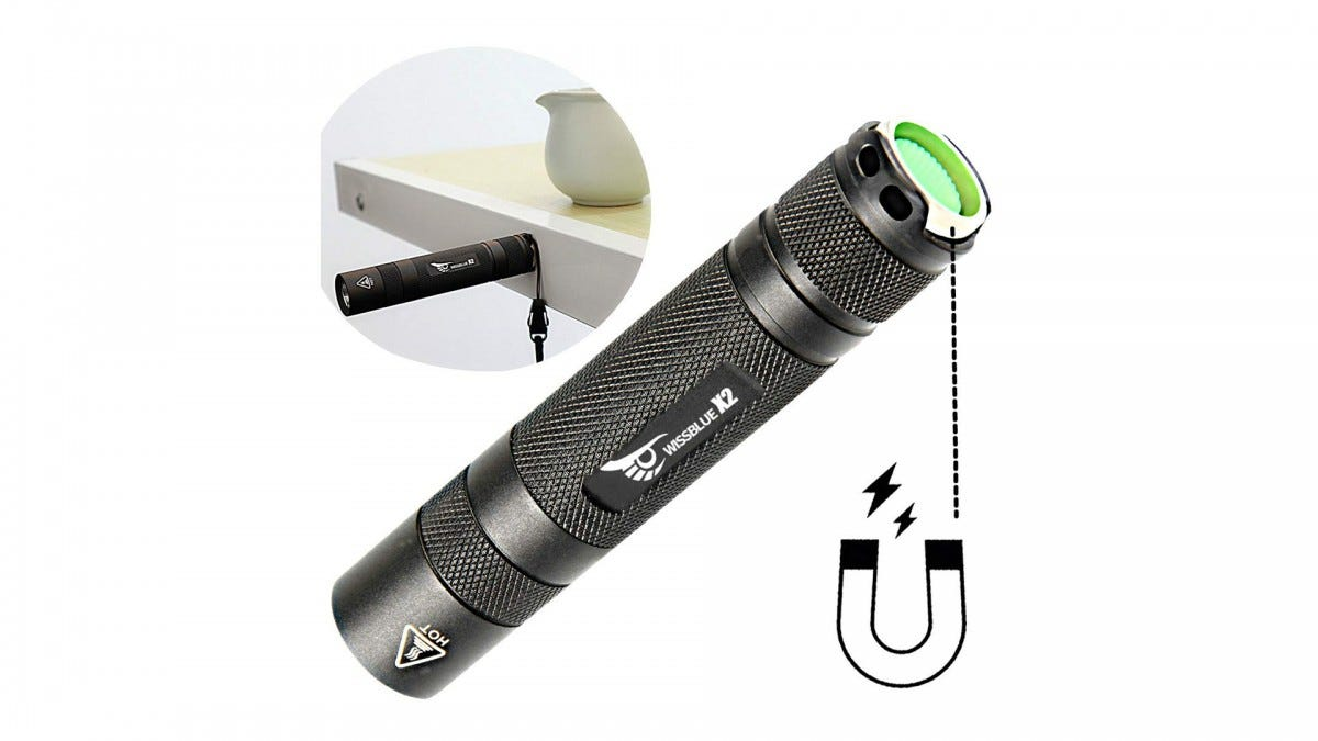 The WISSBLUE tactical flashlight with an inset image of it stuck to the side of a table by its magnet.