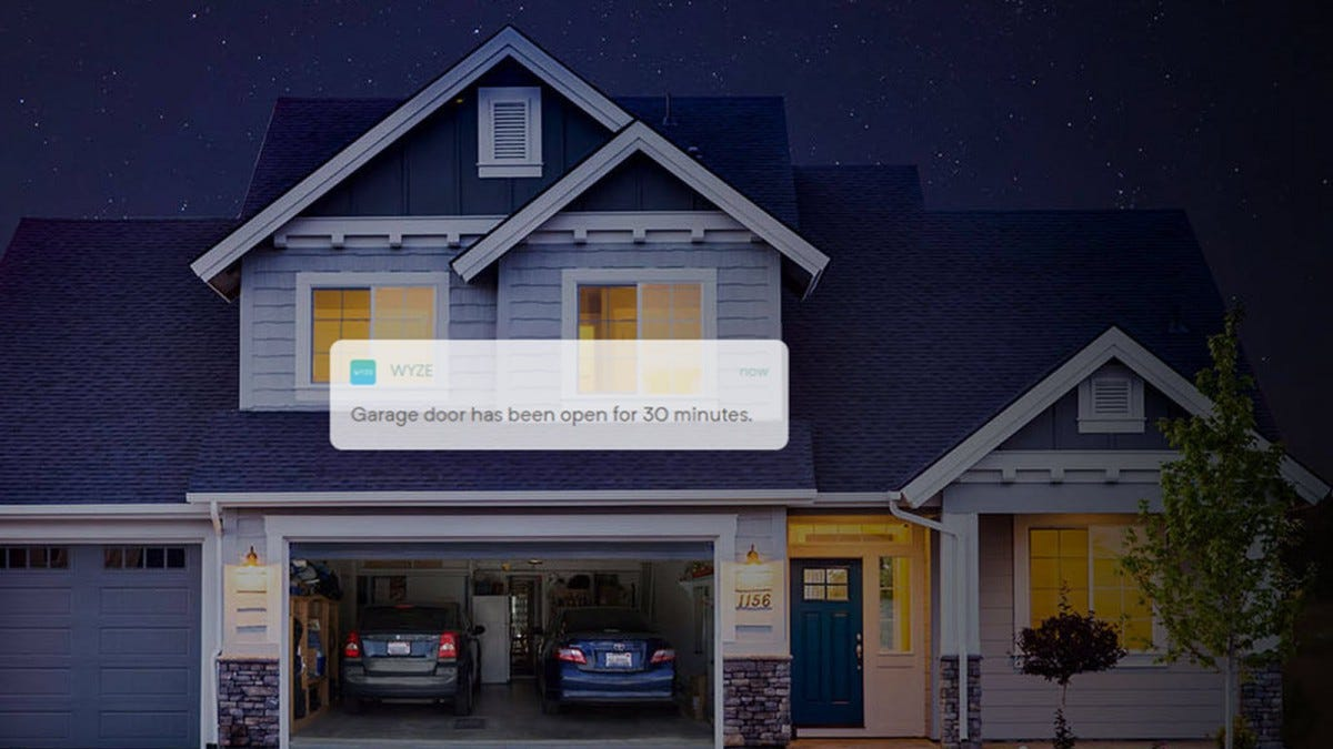 A home with a garage open, and a superimposed Wyze notification stating the garage door has been open for 30 minutes.