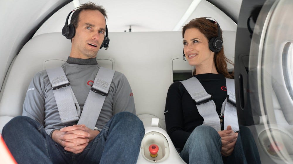 Company co-founder Josh Giegel and head of Passenger Experience Sara Luchian,sitting in the Virgin Hyperloop pod