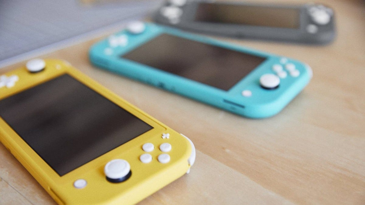 Three Nintendo Switch lite consoles in yellow, blue, and grey.