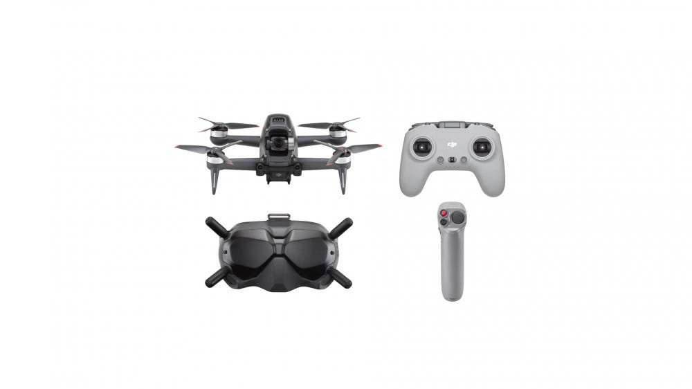 The drone, a pair of goggles, a standard controller, and a motion controller.
