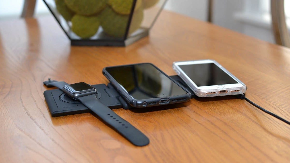 An Apple Watch, iPhone 8 Plus, and iPhone 8 on an Unravel charger