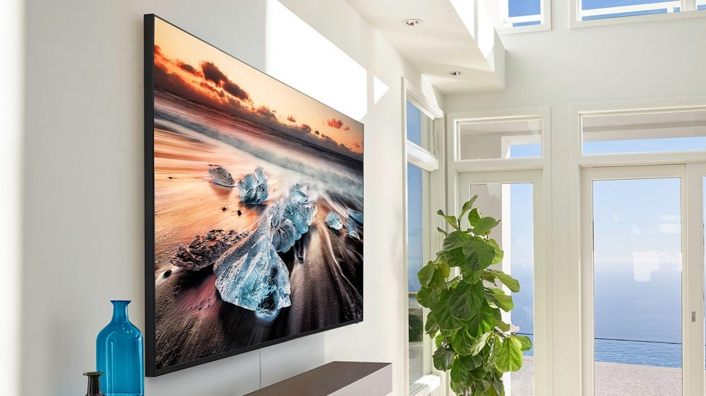 A Samsung QLED TV in a well-lit living room.