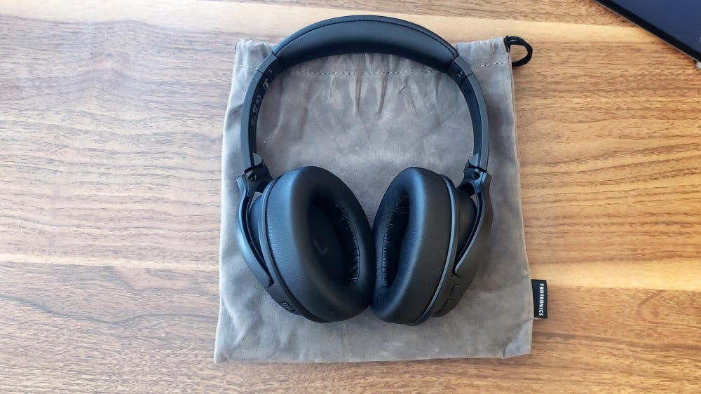 A photo of the TaoTronics ANC headphones with its included carrying case.