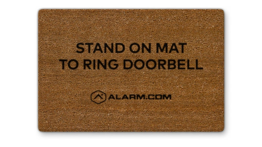 The Alarm.com Touchless Video Doorbell floor mat accessory.