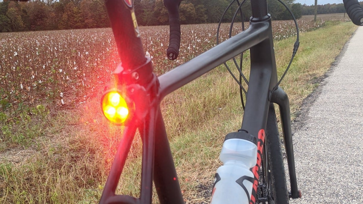 The LEZYNE Zecto Drive Max mounted on a gravel bike next to a cornfield.