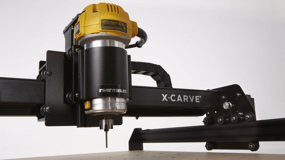 A X-Carve CNC machine with spinning carve bit.