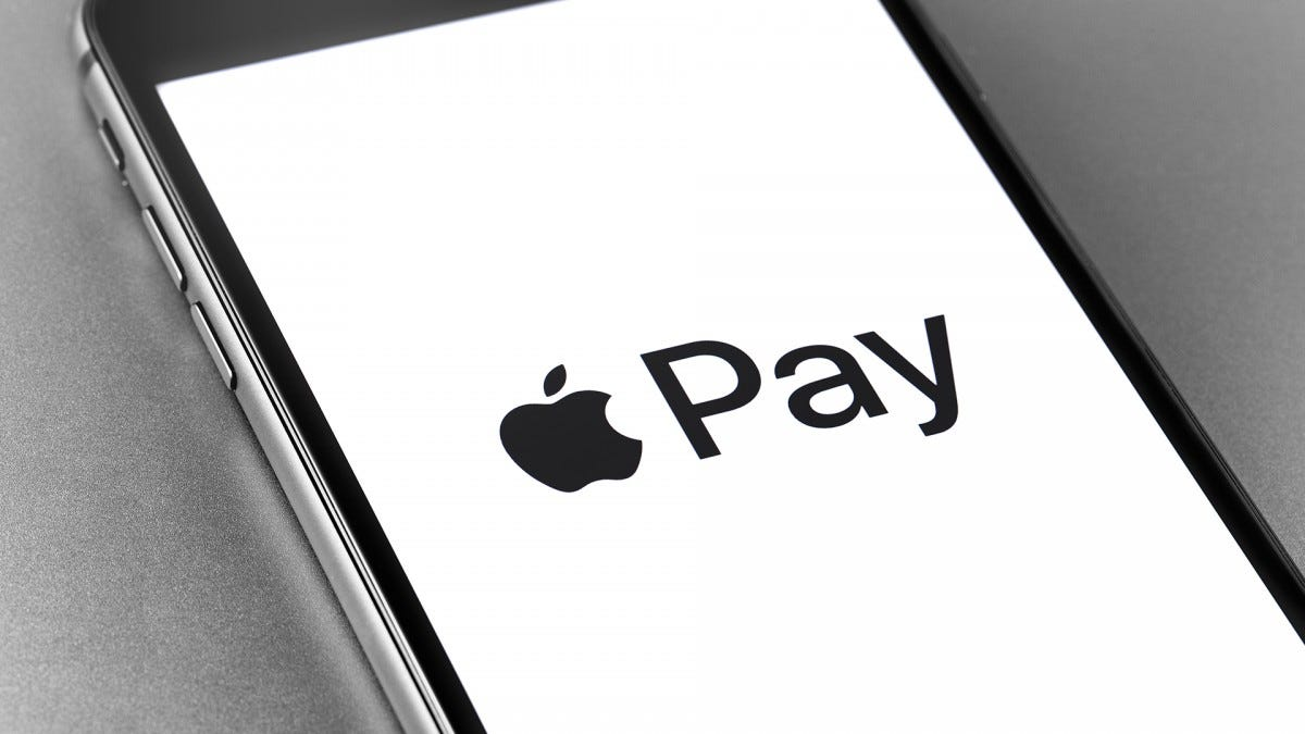 The Apple Pay logo on a phone screen.