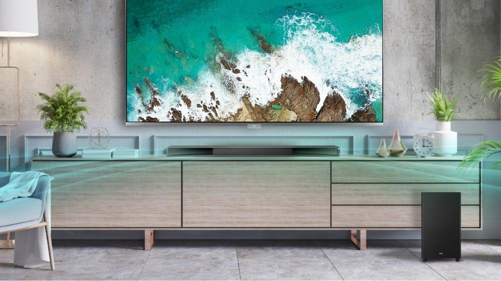 A TCL soundbar on a tv stand.
