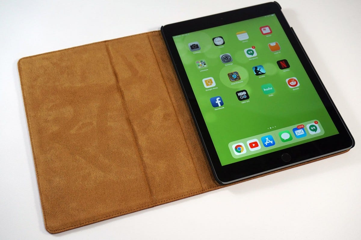 The exterior is full Italian leather with suede interior, with soft-touch plastic for the tablet tray.