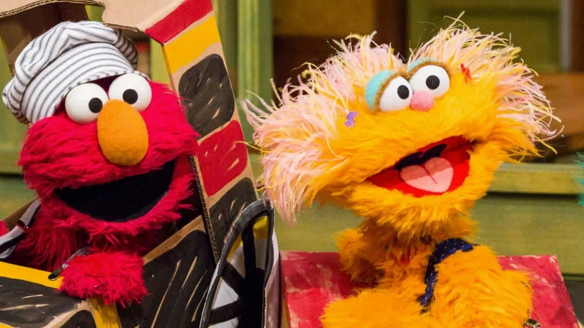 Elmo and Zoe Sesame street characters laughing in a game.