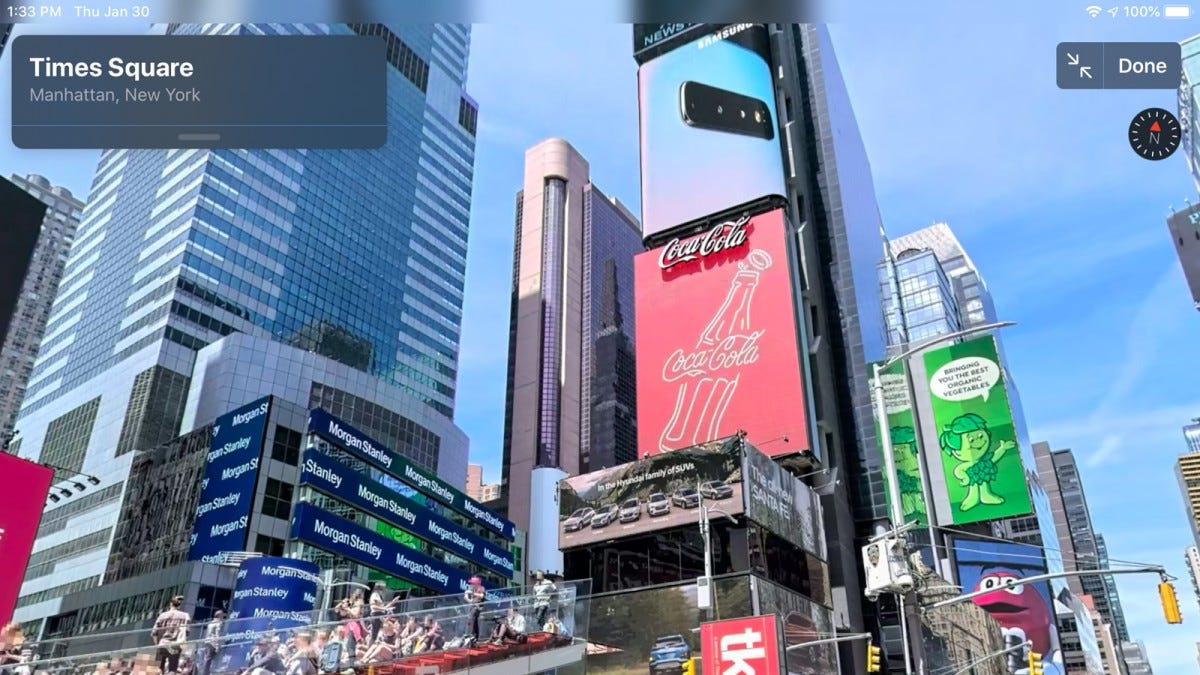 A photo looking up at the Times Square billboard.