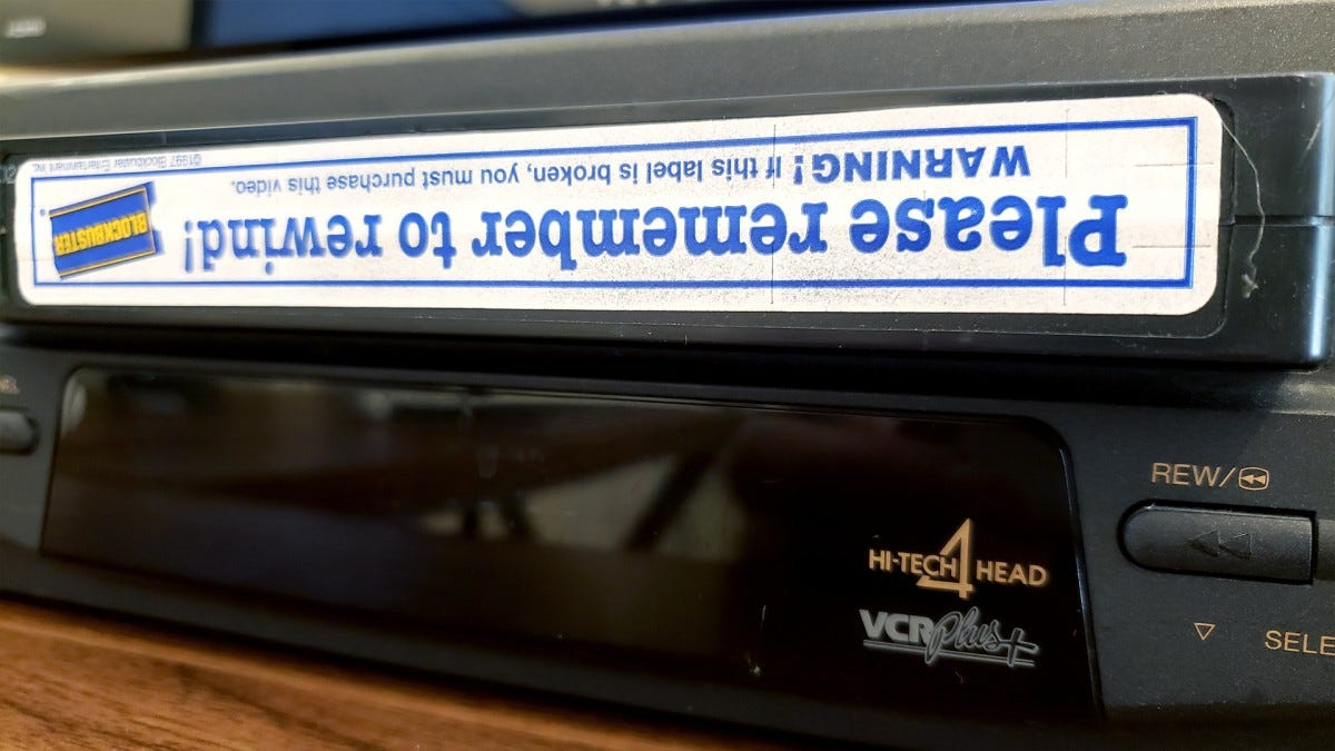 A VHS tape being inserted into a VCR.