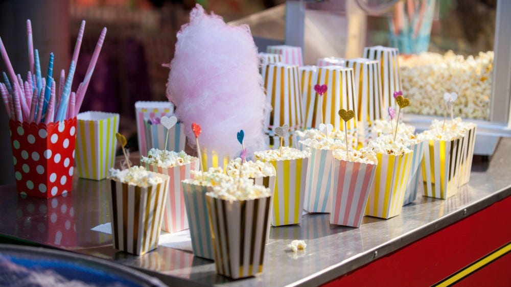 Popcorn in vintage containers and cotton candy ready for the movies