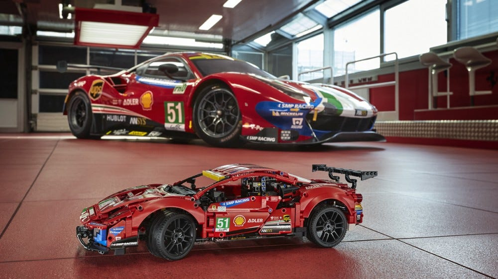 "LEGO Technic Ferrari 488 GTE ""AF Corse #51"" in front of its real-life counterpart"