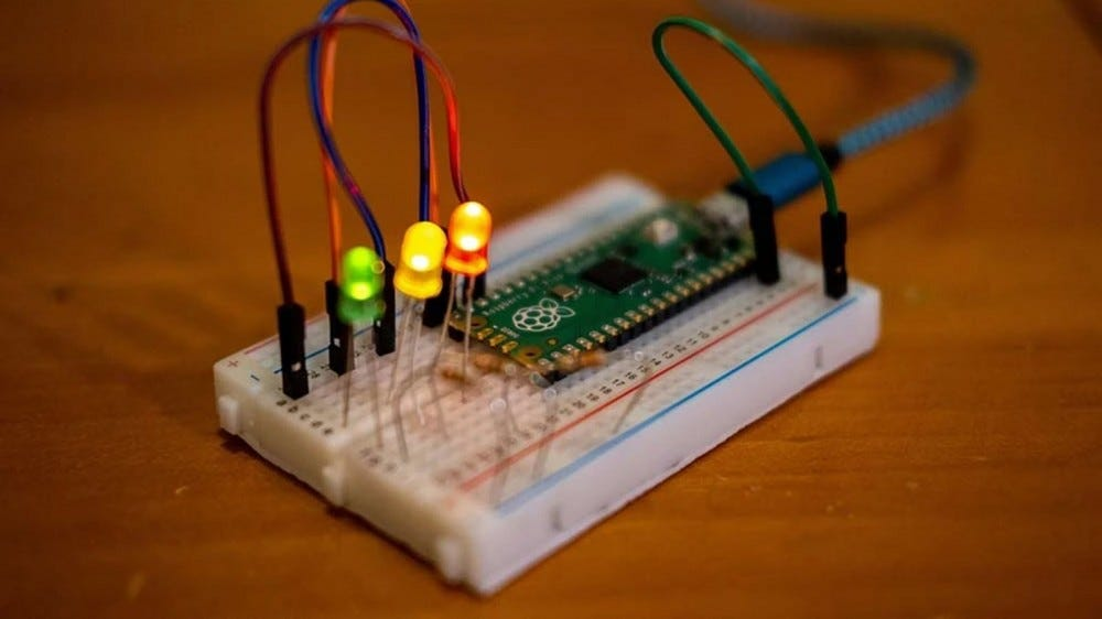 Some LEDs are attached to a breadboard with a Pi Pico
