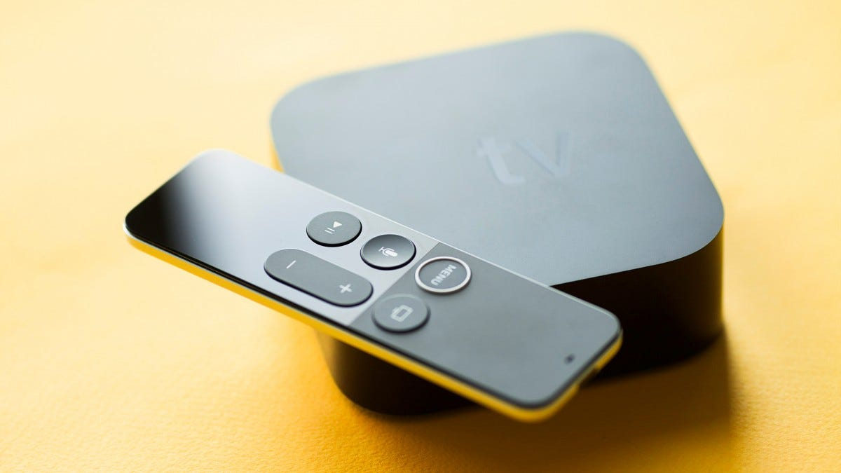 An Apple TV streaming box on a table