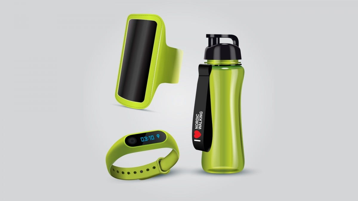 A smartphone and fitness watch in sport holders next to a water bottle.