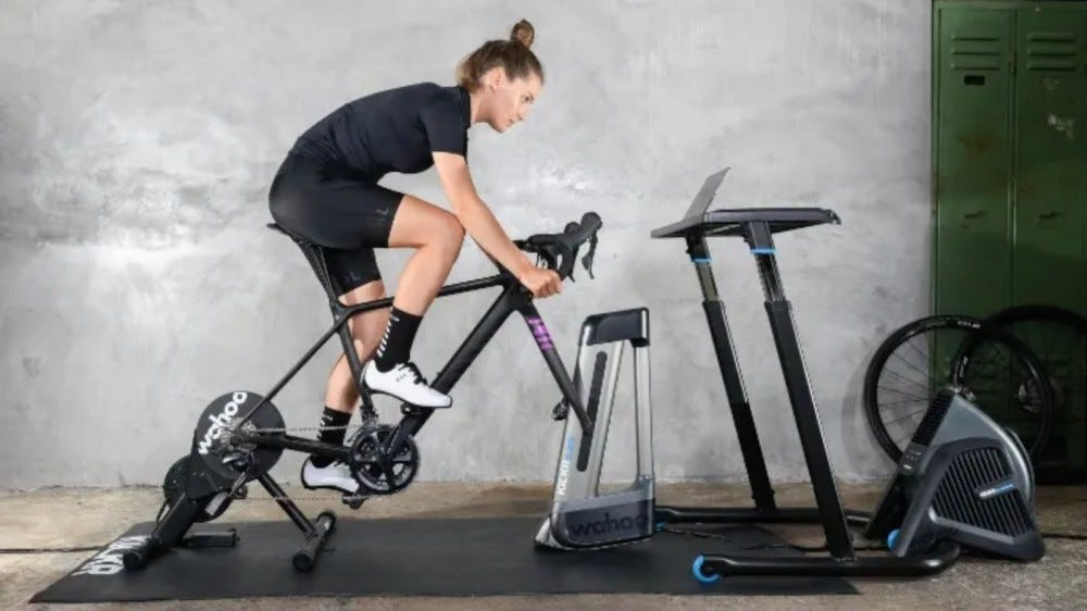 Woman on Wahoo Kickr Core in a gym