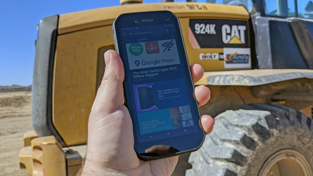 CAT S42 in front of a CAT backhoe