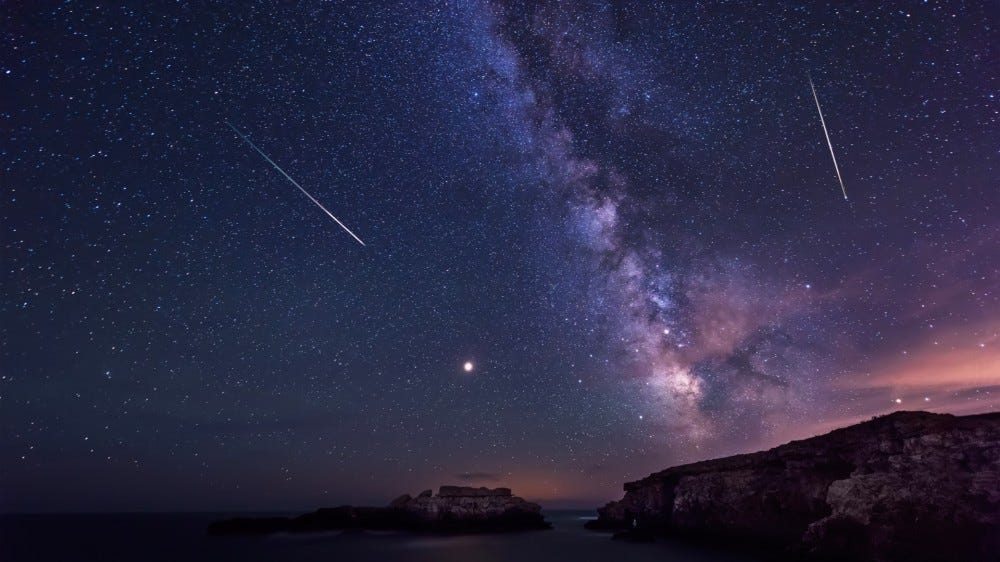 Long exposure night landscape with planet Mars and Milky Way galactic center visible during Perseids meteor shower above the Black Sea in Bulgaria